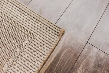 Laminate parquete floor with beige soft carpet