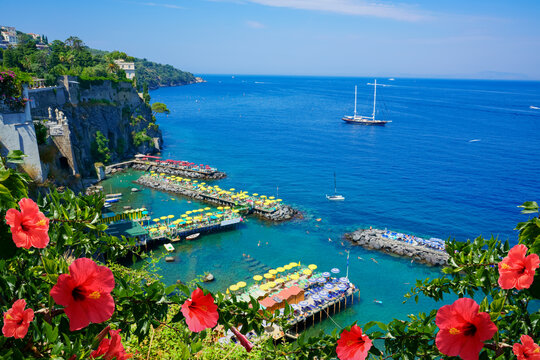 Red flowers. Top view at Sorrento harbor, Amalfi coast, Italy
