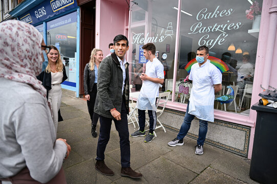 Britain's Chancellor of the Exchequer Rishi Sunak meets with local business people during a visit to Rothesay