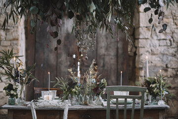 Table decorated for wedding inside an old barn