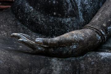 Foto auf Acrylglas Historische denkmal Detail of hands of a Buddha statue, Sukhothai Historical Park, Thailand.