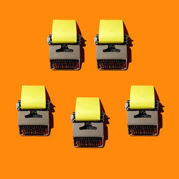 Typewriters on Orange Backdrop