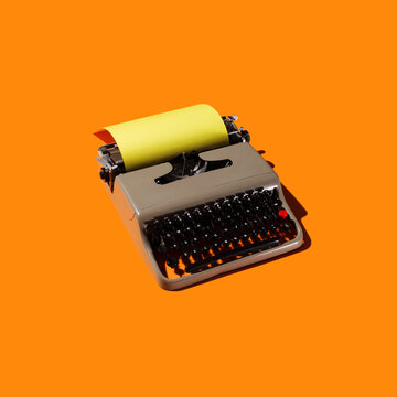 Typewriter on Orange Backdrop
