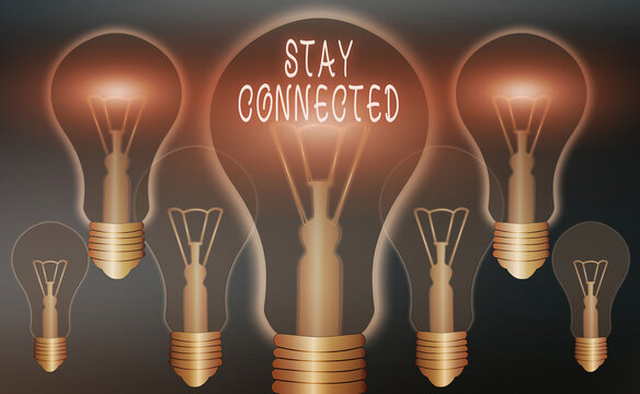 Conceptual hand writing showing Stay Connected. Concept meaning to remain having social professional commercial relationship Realistic colored vintage light bulbs, idea sign solution