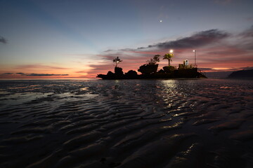 Low tide dusk at Willy rock. White beach. Aklan. Western Visayas. Philippines