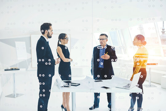 Crew of professional male and female colleagues creating strategy planning for startup discussing ideas together, elegantly formally dressed business partners discussing collaboration details