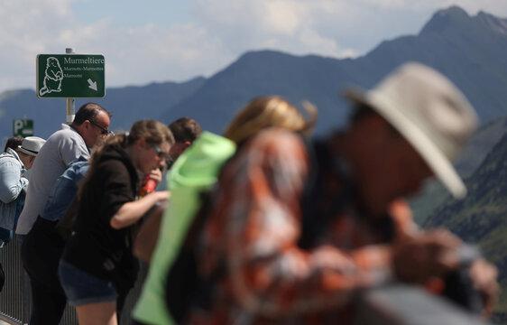 Tourists look down to spot marmots at Kaiser-Franz-Josefs-Hoehe near Heiligenblut
