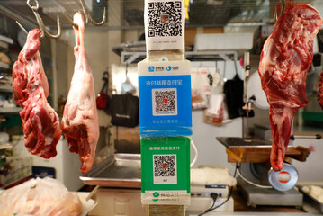 QR code of digital payment services at a fresh market in Beijing