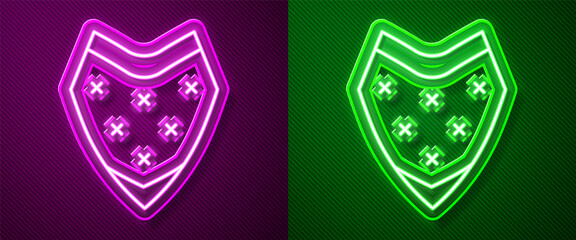 Glowing neon line Traditional mexican poncho clothing icon isolated on purple and green background. Vector.