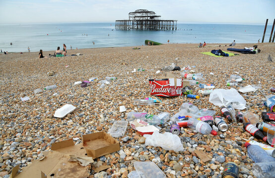 People enjoy the sunny weather on the beach, in Brighton