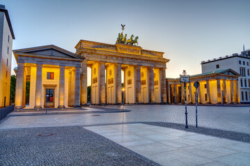 The famous illuminated Brandenburg Gate in Berlin at sunset with no people