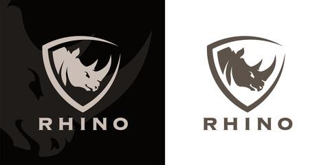 Concept Rhino head and shield company logo icon. Premium Rhinoceros brand identity emblem. African animal business sign. Vector illustration.