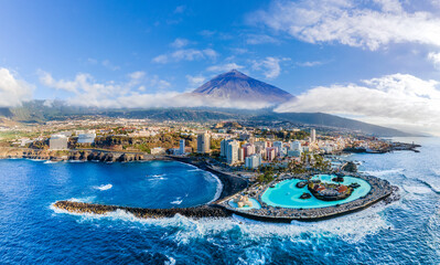 Aerial view with Puerto de la Cruz, in background Teide volcano, Tenerife island, Spain
