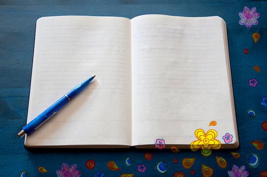 Doodle_paper notebook_blank_pen_flowers_ornaments_blue background