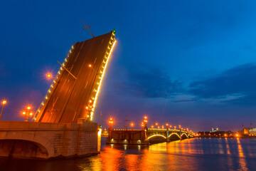 Wall Murals Bridges Saint Petersburg. Russia. Rivers Of St. Petersburg. Bridges Of St. Petersburg. Bridge raising. Trinity bridge over the Neva river is divorced. Evening city illumination. Travel to Russia.