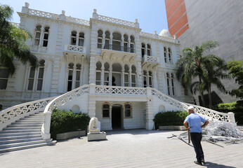 A man stands near the partly damaged Sursock Museum following Tuesday's blast