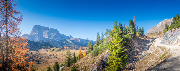 Panorama over Dolomites at between Three Peaks (Tre Cime, Drei Zinnen) and Fanes-Sennes-Prags National Parks during sunset and golden Autumn, South Tyrol, Italy, sunny day