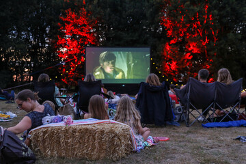 """People watch the movie The Goonies at """"Sundown Cinema"""", an outdoor cinema which began during the coronavirus disease (COVID-19) outbreak, in a field in Ripley"""