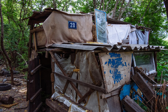 Homeless dweling. Small habitation made from garbage in dirty littered forest