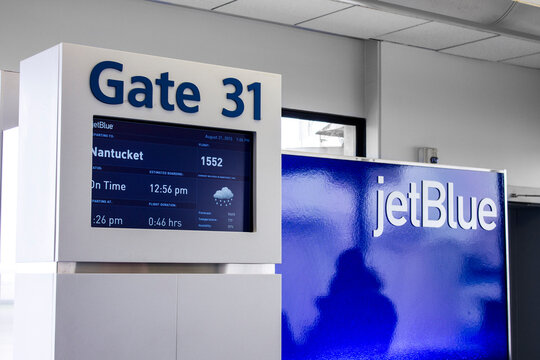 Boston, Massachusetts. JetBlue Gate 31 at Boston General Edward Lawrence Logan International Airport, with a flight announced for Nantucket island in the information panel