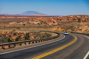 Fotobehang Route 66 Asphalt road in USA. Barren scenery. Desert highway of the American southwest. Endless straight. Route 66, Arizona California.