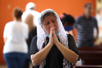 Lebanese Christians hold Sunday mass in a damaged church following Tuesday's blast in Beirut