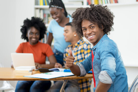 Smart african american computer science student with group of students
