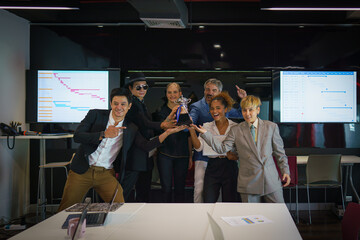 diverse people celebrate teamwork to win trophy award and certificate