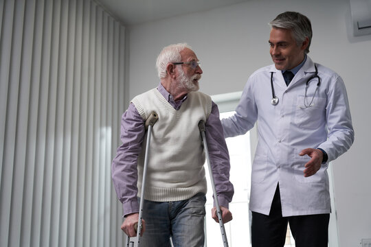 General practitioner taking a walk with his elderly patient