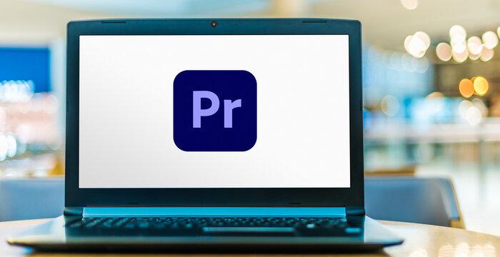 Laptop computer displaying logo of Adobe Premiere Pro