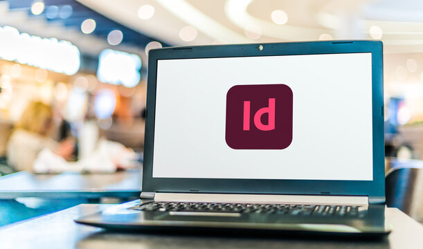 Laptop computer displaying logo of Adobe InDesign