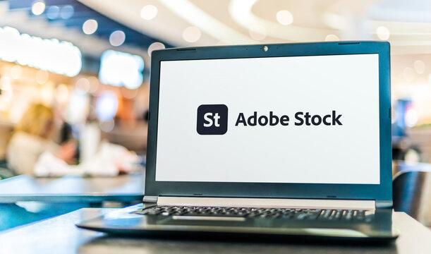 Laptop computer displaying logo of Adobe Stock