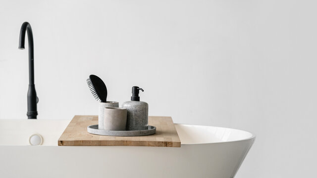 Modern bathroom interior with bathtub and water tap