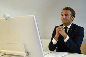 French President Emmanuel Macron reacts during a donor teleconference with other world leaders, in Bormes-les-Mimosas