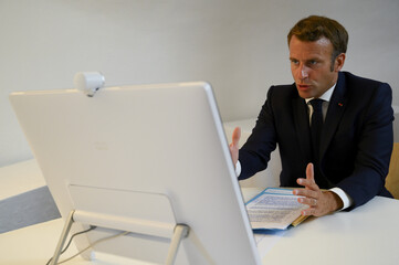 French President Emmanuel Macron speaks during a donor teleconference with other world leaders, in Bormes-les-Mimosas