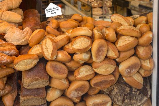 Fresh bread rolls and loaf of bread in bakery window