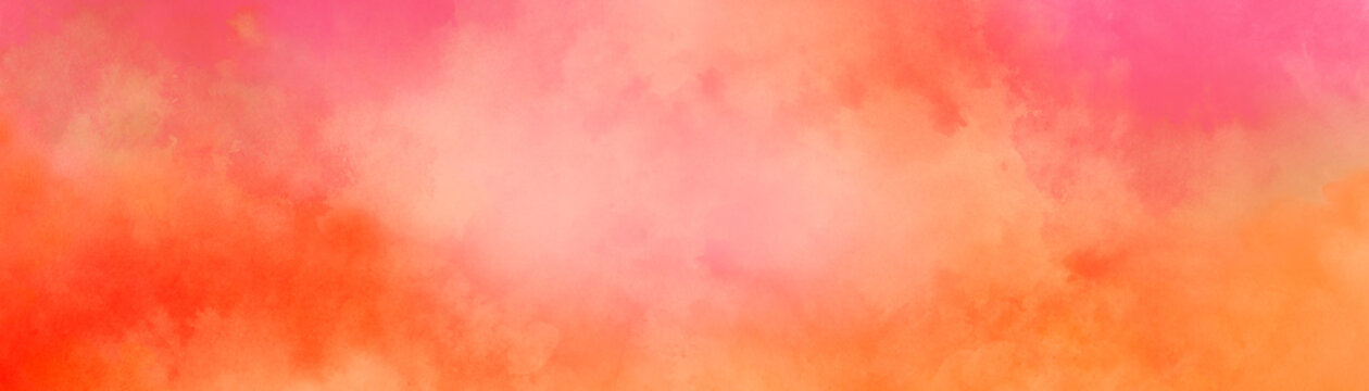 Colorful watercolor background of abstract sunset sky with puffy clouds in bright rainbow colors of orange pink yellow and purple