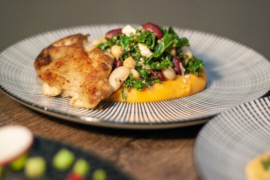 Southwest Bean Salad with red beans, chick peas, cannellini beans, kale, cottage cheese, roast chicken on dark Slate Gray Concrete Wall background