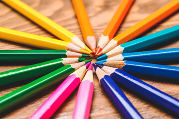 Set of colorful pencils on wooden background