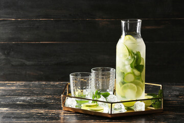 Glassware of fresh mojito on table