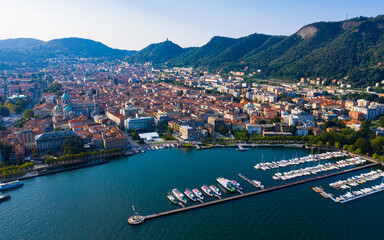 View of residential areas of Italian city of Como with Cathedral and famous Como Lake in sunny day