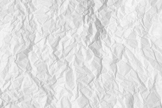 Texture of crumpled white parchment or paper. Abstract background for design. Blank with copy space.