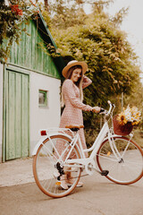 Happy woman with bicycle in countryside