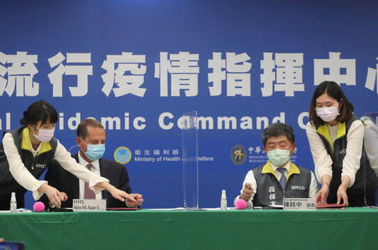 U.S. Secretary of Health and Human Services (HHS) Alex Azar and Taiwan Minister of Health and Welfare Chen Shih-chung attend a signing ceremony at the Central Epidemic Command Center in Taipei