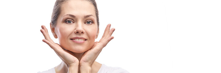 Happy pretty woman. Hands near face. Skincare concept. Home morning routine. Clean skin. Cream cosmetics. Cosmetology therapy. Rejuvenation procedure. White background. Copyspace