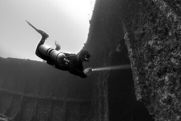 Scuba diver underwater with shipwreck  Wall mural