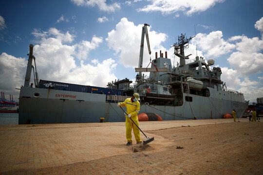 A worker cleans the docking area at the Beirut's port