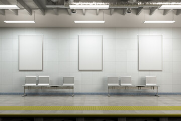 Three blank vertical posters mock up on the wall of underground subway station.
