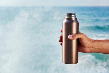man with an aluminum reusable water bottle