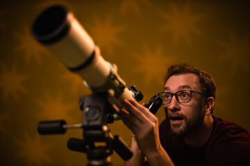 Amateur astronomer looking at the stars with a telescope. Astronomy and astrology concept.